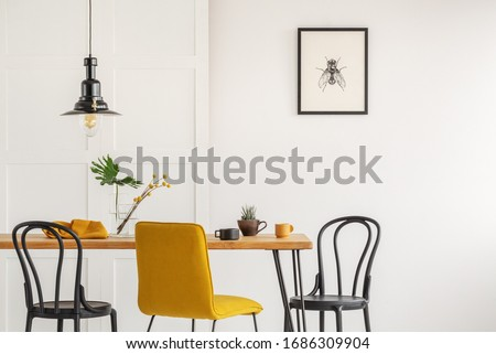 Stylish yellow chair at wooden dining table in trendy interior Royalty-Free Stock Photo #1686309904