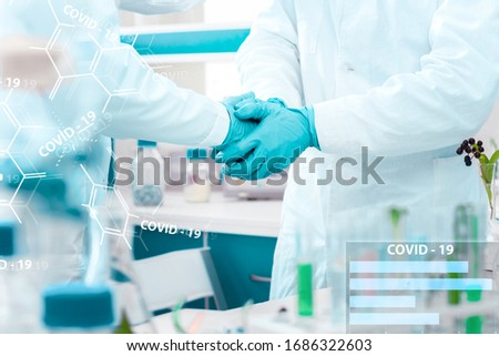 Closeup scientists handshake in medical gloves in laboratory. Pharmacists virologists invented vaccine against virus SARS-CoV-2, 2019-nCoV, Covid-19. Coronavirus pandemic epidemic concept. #1686322603