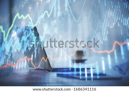 Double exposure of graph and financial info and work space with computer background. Concept of international online trading. #1686341116