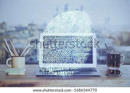 Computer on desktop in office with finger print drawing. Double exposure. Concept of business data security. #1686344770