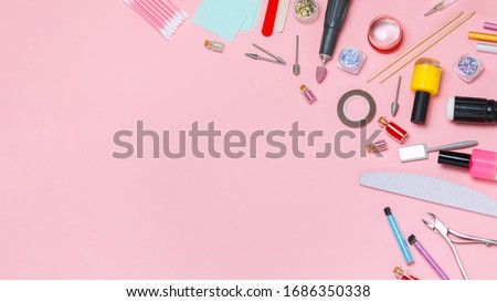 Nail care. A set of professional tools for manicure and pedicure. Beauty care. Coating nails with gel polish. Tools for creating and for the treatment of nails. Salon Banner Pink Background #1686350338