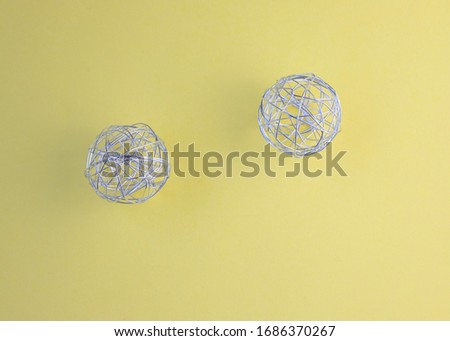 wire balls on yellow and black background #1686370267