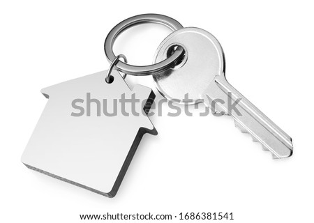 House key with a house shaped keychain, isolated on white background Royalty-Free Stock Photo #1686381541