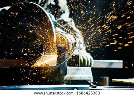 man working grinder cutting machine Royalty-Free Stock Photo #1686425380
