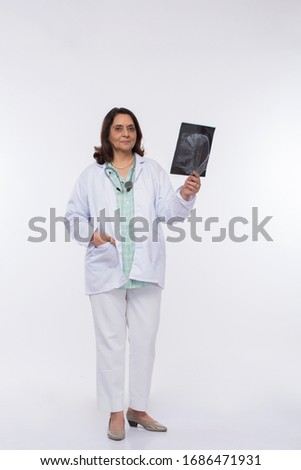 woman doctor check xray isolated on white background. #1686471931