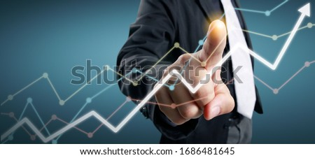 Hand touching a graphs of financial indicator and accounting market economy analysis chart #1686481645