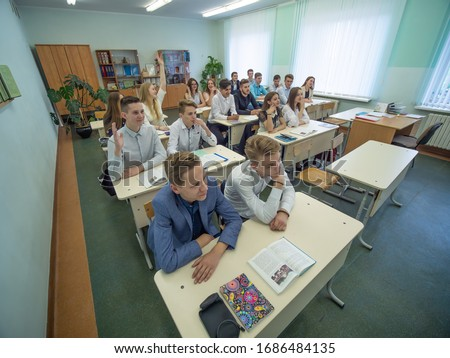 Students during the lesson are sitting at their desks. Russian school. #1686484135