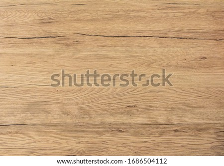 Wood texture background. Top view of vintage wooden table with cracks. Light brown surface of old knotted wood with natural color #1686504112