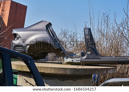 Disassembled body of the car. Royalty-Free Stock Photo #1686504217