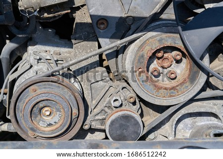 Belt drive on disassembled car Royalty-Free Stock Photo #1686512242