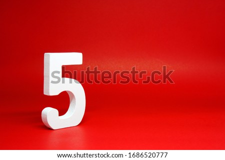 Five ( 5 ) white number wooden Isolated Red Background with Copy Space - New promotion 5% Percentage  Business finance Concept  Royalty-Free Stock Photo #1686520777