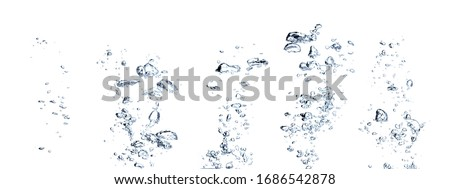 Real Images of small air water bubbles  or soda floating up to water surface. Gas power in carbonate refreshing on white background Royalty-Free Stock Photo #1686542878