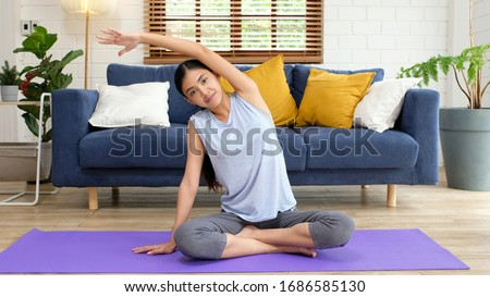 Exercise at home, Healthy asian girl body stretch for workout fitness while stay home, Asia woman exercising in house, Quarantine female people do yoga for relaxing, social distancing, wellbeing  #1686585130