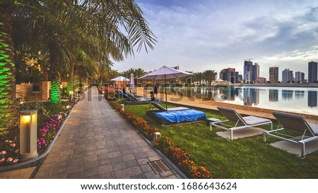 MANAMA/BAHRAIN - April 8, 2019: Small sandy beach at Reef resort with a view of Bahrain city #1686643624