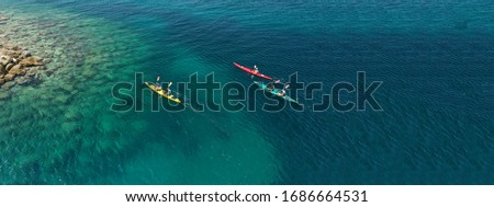 Aerial drone ultra wide photo of young couple canoeing in tropical exotic island bay Royalty-Free Stock Photo #1686664531