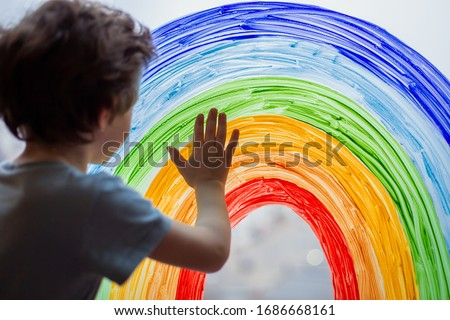 Chase the rainbow. child at home draws a rainbow on the window. Flash mob society community on self-isolation quarantine pandemic coronavirus. Children create artist paints creativity vacation #1686668161
