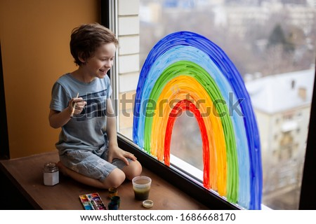 let's all be well. child at home draws a rainbow on the window. Flash mob society community on self-isolation quarantine pandemic coronavirus. Children create artist paints creativity vacation #1686668170