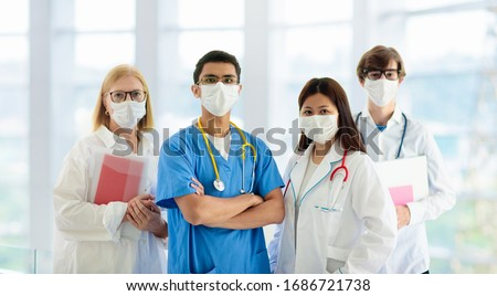 International doctor team. Hospital medical staff. Mixed race Asian and Caucasian doctor and nurse meeting. Clinic personnel wearing face mask and stethoscope. Coronavirus outbreak. #1686721738