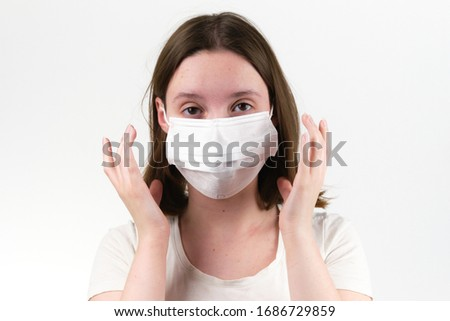 girl in a respiratory medical mask #1686729859
