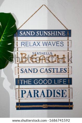 Nautical beach sign made of white washed wood slats with words on them, beach, sand castles, paradise, sunshine, good life #1686741592