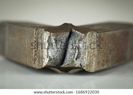 The low carbon steel that has been applied fracture test. Fracture test is applying to predict materials whether ductile or brittle. This kind of tests are called as Charpy and Izod test. Macro photo Royalty-Free Stock Photo #1686922030