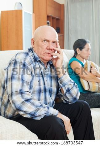 Family quarrel. Upset senior man against sad wife at home #168703547
