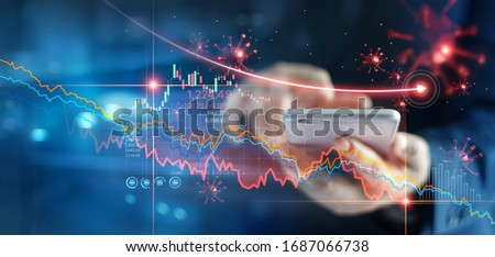 Economic crisis, Businessman using mobile smartphone analyzing sales data and economic graph chart that is falling due to the corona virus crisis, Covid-19, stock market crash caused.  #1687066738
