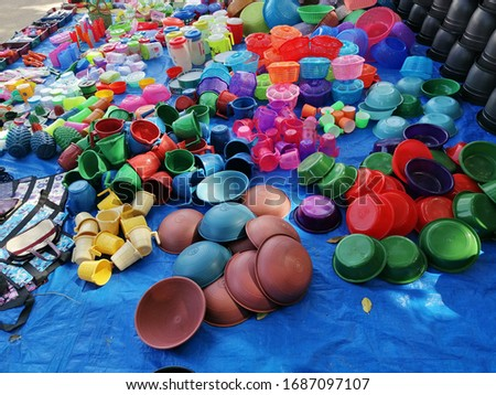 Plastic items sale in the road side. Plastic items cause plastic pollution. #1687097107