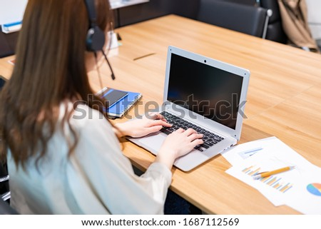 Business woman teleworking in conference room #1687112569