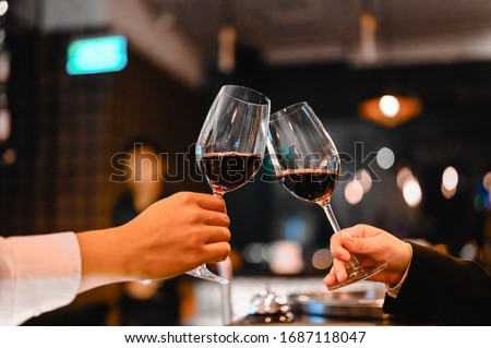 Two bartender enjoying of Cheers glass of wine for wine tasting event in a restaurant  at sunset. bartender, tasting, Dinner, Wine, beverage, dinner concept. #1687118047