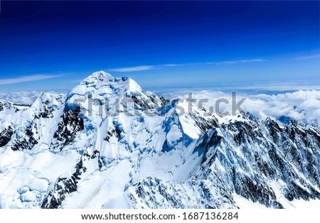 Winter mountain peak snow view. Snowy winter mountain peak snow. Winter mountain peak snow. Snow covered winter mountain peak landscape #1687136284