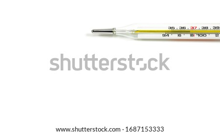 Glass mercury thermometer used for measuring body temperature On a white background The picture at the top right corner has a copy space taken at the top corner.