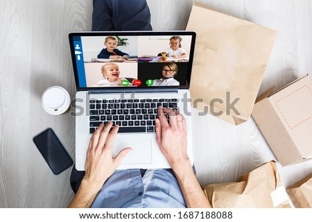 Cropped image of cheerful blogger having funny conversation with best friend in video chat on modern touchpad connecting to wireless 4G internet.Young man sharing impressions of trip on webcam #1687188088