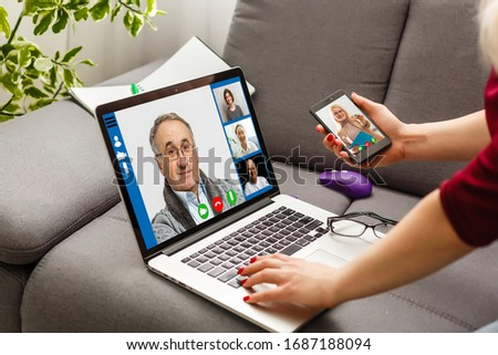 Cropped image of young woman using laptop for video conference at home #1687188094