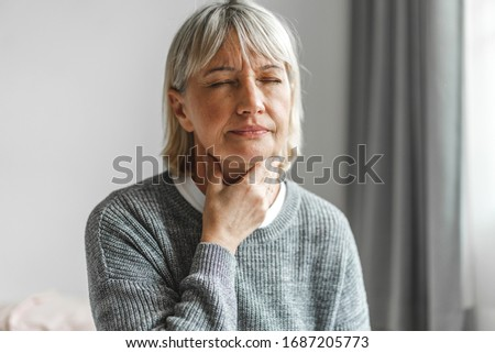 Sick senior adult elderly women touching the neck feeling unwell coughing with sore throat pain.Healthcare and medicine concept Royalty-Free Stock Photo #1687205773