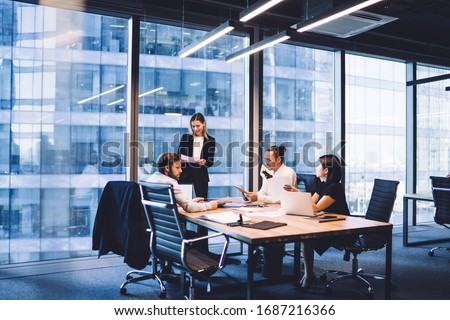 Professional financial experts collaborating during brainstorming meeting listening information from clever female director, businesswoman providing information to corporate workers of company #1687216366