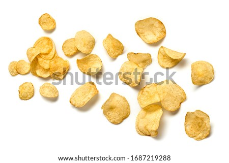 Potato chips flying. Vegan beer snack isolated on white. Crispy home made veggie chip, levitation fly creative concept. Falling potato crisps background, top view #1687219288