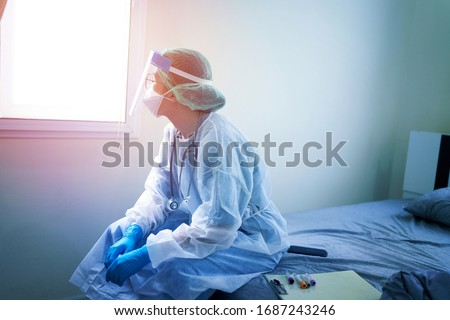 doctor in PPE suit uniform has stress in Coronavirus outbreak or Covid-19, Concept of Covid-19 quarantine.Emotional stress of overworked doctor and medical care team during covid-10 period.  #1687243246