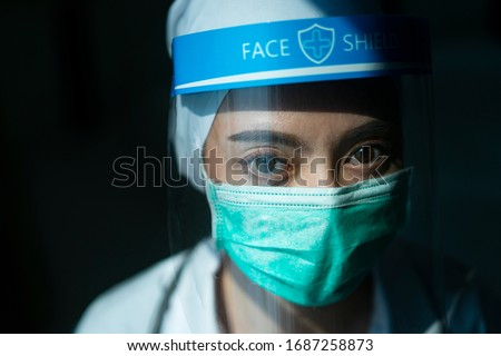Closeup Asian female Doctor wearing face shield and PPE suit for Coronavirus outbreak or Covid-19, Concept of Covid-19 quarantine #1687258873