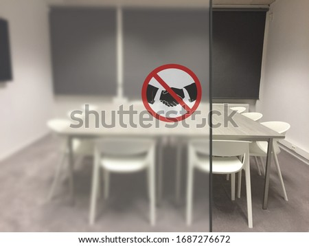 No handshake concept, changing greetings habits. No handshake concept, Sign at the netrance of an empty meeting room in a company