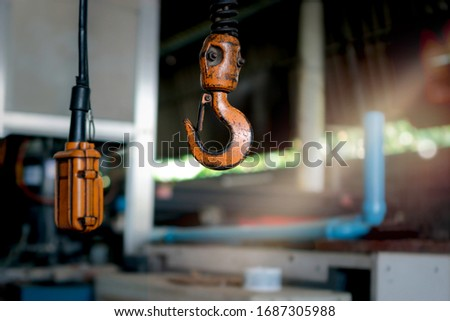 Metal hook hanging on chain in factory, equipment and mechanical device, manufacturing plant in industrial site #1687305988