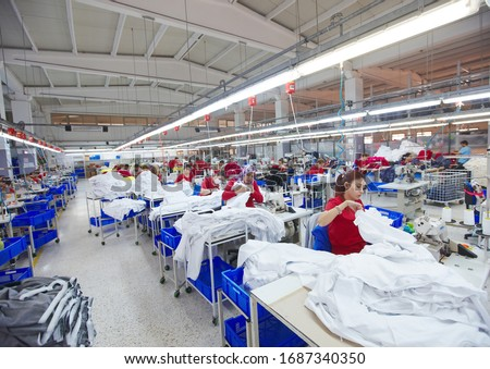Textile cloth factory working process tailoring workers equipment Royalty-Free Stock Photo #1687340350