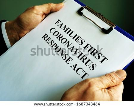 Businessman reads families first coronavirus response act FFCRA. Royalty-Free Stock Photo #1687343464