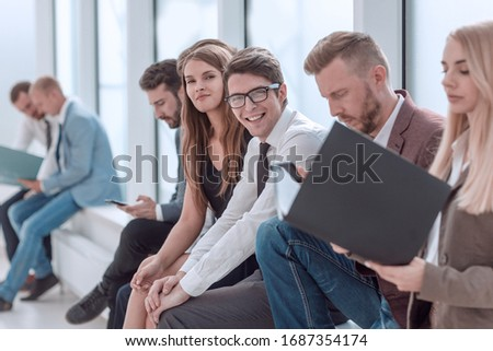 young business people sitting in the office corrido #1687354174
