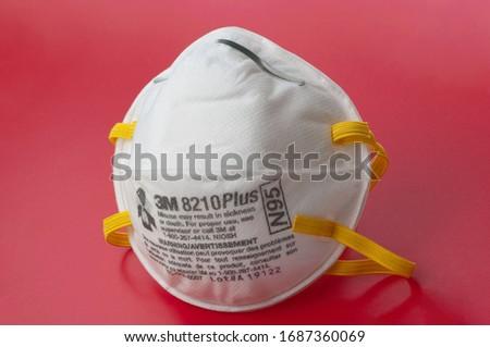 Kyiv, Ukraine - March 13 2020: Novel Coronavirus outbreak concept. 3M respiratory mask. Hospital or pollution protect face masking. #1687360069
