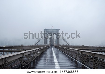 Brooklyn bridge, New York City. USA. New York in a foggy day in downtown Manhattan. Deserted city. Royalty-Free Stock Photo #1687368883