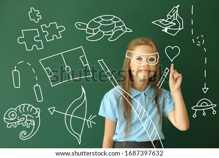 Little schoolgirl with raised index finger and many drawings on color background