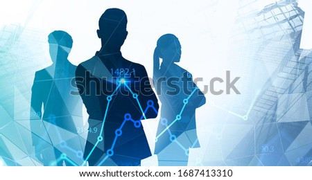 Silhouettes of three successful managers standing together in abstract city with double exposure of blurry digital graph. Concept of teamwork and stock market. Toned image #1687413310