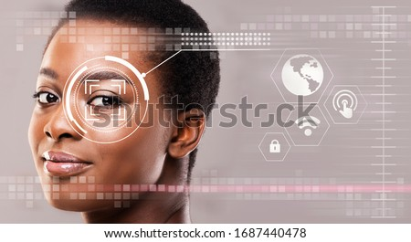 Personal surveillance concept. Iris scan of African American girl, creative collage with info on transparent screen. Copy space. Panorama #1687440478