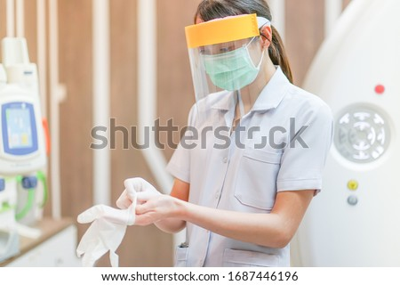 Medical staff wearing face shield, medical mask and medical grove for protect coronavirus covid-19 virus in CT scan room, protective Epidemic virus outbreak concept Royalty-Free Stock Photo #1687446196